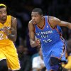 Oklahoma City\'s Kevin Durant (35) drives up court as Los Angeles\' Jordan Hill (27) defends during Game 4 in the second round of the NBA basketball playoffs between the L.A. Lakers and the Oklahoma City Thunder at the Staples Center in Los Angeles, Saturday, May 19, 2012. Photo by Nate Billings, The Oklahoman