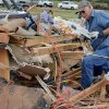 Tom Green helps recover items out of his daughter\'s home that was destroyed by Tuesday\'s tornado west of El Reno, Wednesday, May 25, 2011. Photo by Chris Landsberger, The Oklahoman
