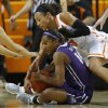 Oklahoma State\'s Tiffany Bias (3) reaches for the ball over TCU\'s Zahna Medley (14) during a women\'s college basketball game between Oklahoma State University and TCU at Gallagher-Iba Arena in Stillwater, Okla., Tuesday, Feb. 5, 2013. Oklahoma State won 76-59. Photo by Bryan Terry, The Oklahoman
