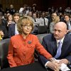 Former Arizona Rep. Gabrielle Giffords, who was seriously injured in the mass shooting that killed six people in Tucson, Ariz. two years ago, sits with her husband, Mark Kelly, right, a retired astronaut, on Capitol Hill in Washington, Wednesday, Jan. 30, 2013, prior to speaking before the Senate Judiciary Committee hearing on what lawmakers should do to curb gun violence in the wake of last month\'s shooting rampage at that killed 20 schoolchildren in Newtown, Ct. (AP Photo/J. Scott Applewhite)