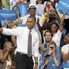 Photo -   President Barack Obama waves to supporters after speaking at a campaign event at Schiller Park Monday, Sept. 17, 2012, in Columbus, Ohio. (AP Photo/Tony Dejak)