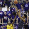 Photo - TCU center Karviar Shepherd (1) shoots against Iowa State forward Melvin Ejim (3) during the first half of an NCAA college basketball game Saturday, Feb. 22, 2014, in Fort Worth, Texas. (AP Photo/LM Otero)