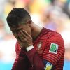 Photo - Portugal's Cristiano Ronaldo reacts during the group G World Cup soccer match between Portugal and Ghana at the Estadio Nacional in Brasilia, Brazil, Thursday, June 26, 2014.  Portugal won 2-1 but were eliminated from the competition.  (AP Photo/Paulo Duarte)