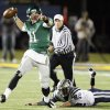 Edmond Santa Fe quarterback Justice Hansen (11) gets away from Russell Sivard (92) of Edmond North during a high school football game between Edmond Santa Fe and Edmond North at Wantland Stadium in Edmond, Okla., Friday, Oct. 28, 2011. Photo by Nate Billings, The Oklahoman