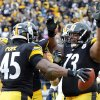 Photo - Pittsburgh Steelers tight end Leonard Pope (45) celebrates with guard Ramon Foster (73) after making a touchdown catch in the second quarter of an NFL football game against the Cleveland Browns, Sunday, Dec. 30, 2012, in Pittsburgh. (AP Photo/Don Wright)
