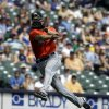 Miami Marlins second baseman Derek Dietrich makes a throw to first on a ball hit by Milwaukee Brewers\' Logan Schafer during the third inning of a baseball game on Sunday, July 21, 2013, in Milwaukee. Schafer was safe at first on the play. (AP Photo/Morry Gash)