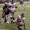 New York Giants running back Ahmad Bradshaw (44) rushes past New England Patriots\' Brandon Spikes (55) and Giants\' Chris Snee (76) for a touchdown during the second half of the NFL Super Bowl XLVI football game, Sunday, Feb. 5, 2012, in Indianapolis. (AP Photo/David Duprey) ORG XMIT: SB449