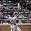 Photo - Washington Nationals' Ian Desmond hits a two-run home run during the sixth inning of a baseball game against the New York Mets Tuesday, Aug.12, 2014, at Citi Field in New York. (AP Photo/Bill Kostroun)