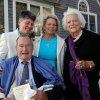 In this Sept. 21, 2013 photo, former President George H.W. Bush, front left, former first lady Barbara Bush, right, pose for photos after wedding of longtime friends Helen Thorgalsen, center, and Bonnie Clement, in Kennebunkport, Maine. Bush was an official witness at the same-sex wedding, his spokesman said Wednesday, Sept. 25, 2013. (AP Photo/Susan Biddle)
