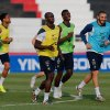 Photo - France's Paul Pogba, green shirt, center, smiles with Karim Benzema, blue shirt, as they run in the field during a training session of the French national soccer team at the Santa Cruz Stadium in Ribeirao Preto, Brazil, Wednesday, June 11, 2014. France will face Ecuador, Switzerland and Honduras in group E of the 2014 Soccer World Cup. (AP Photo/David Vincent)