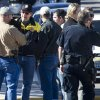 Law enforcement officials confer during an investigation into a shooting and fire in Boulder City, Nev., Monday, Jan. 21, 2013. Las Vegas police spokeswoman Carla Alston confirmed that a Las Vegas police officer was involved in the 9 a.m. Monday incident. She says Henderson police are handling the investigation. (AP Photo/Las Vegas Sun, Steve Marcus)