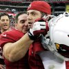 Photo -   Arizona Cardinals' Jay Feely, center, celebrates their 24-21 overtime win over the Miami Dolphins with Kevin Kolb, right, and Mike Leach after an NFL football game, Sunday, Sept. 30, 2012, in Glendale, Ariz. (AP Photo/Ross D. Franklin)