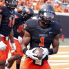 Photo - Oklahoma State's Joseph Randle (1) warms up before a college football game between the Oklahoma State University Cowboys (OSU) and the University of Kansas Jayhawks (KU) at Boone Pickens Stadium in Stillwater, Okla., Saturday, Oct. 8, 2011. Photo by Sarah Phipps, The Oklahoman