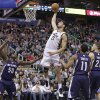 Utah Jazz\'s Enes Kanter (0) dunks as Memphis Grizzlies\' Zach Randolph (50), Mike Conley (11), and Tayshaun Prince (21) watch during the first quarter of an NBA basketball game Wednesday, March 26, 2014, in Salt Lake City. (AP Photo/Rick Bowmer)