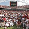 The Sooners pose for a team photo after defeating Texas 55-17 during the Red River Rivalry college football game between the University of Oklahoma Sooners (OU) and the University of Texas Longhorns (UT) at the Cotton Bowl in Dallas, Saturday, Oct. 8, 2011. Photo by Chris Landsberger, The Oklahoman