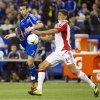 Montreal Impact\'s Felipe Martins knocks the ball away from Toronto FC\'s Adrian Cann during the first half of an Amway Canadian Championship soccer match, Wednesday, May 2, 2012, in Montreal. (AP Photo/The Canadian Press, Paul Chiasson)