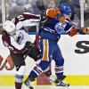 Colorado Avalanche\'s PA Parenteau (15) checks Edmonton Oilers\' Ryan Nugent-Hopkins during the first period of their NHL hockey game, Monday, Jan. 28, 2013, in Edmonton, Alberta. (AP Photo/The Canadian Press, Jason Franson)