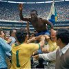 Photo - FILE - In this June 21, 1970 file photo, Brazil's Pele, centre is hoisted on the shoulders of his teammates after Brazil won the World Cup soccer final against Italy, 4-1, in Mexico City's Estadio Azteca, Mexico. On this day: Perhaps the most glorious day in Brazil's World Cup history. Its third World Cup triumph against a strong Italian side meant it kept the Jules Rimet trophy for good. (AP Photo/File)
