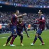 Photo - FC Barcelona's Alexis Sanchez, left, reacts after scoring against Valencia with his teammates Daniel Alves, center, and Pedro Rodriguez during a Spanish La Liga soccer match at the Camp Nou stadium in Barcelona, Spain, Saturday, Feb. 1, 2014. (AP Photo/Manu Fernandez)