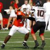 OSU\'s Bobby Reid (14) blocks Texas Tech\'s Daniel Chabonnet during the second half of the college football game between the Oklahoma State University Cowboys (OSU) and the Texas Tech University Red Raiders (TTU) at Boone Pickens Stadium on Saturday, Sept. 22, 2007, in Stillwater, Okla. By MATT STRASEN, The Oklahoman