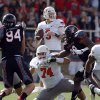 Oklahoma State\'s Brandon Weeden (3) looks to pass during a college football game between Texas Tech University (TTU) and Oklahoma State University (OSU) at Jones AT&T Stadium in Lubbock, Texas, Saturday, Nov. 12, 2011. Photo by Sarah Phipps, The Oklahoman ORG XMIT: KOD