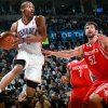 Oklahoma City\'s Russell Westbrook looks for an open teammate in front of pressure from Houston\'s Kyle Lowry and Brad Miller (right) during their NBA basketball game at the OKC Arena in downtown Oklahoma City on Wednesday, Nov. 17, 2010. Photo by John Clanton, The Oklahoman