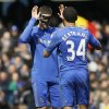 Chelsea\'s players Fernando Torres, left, and Ryan Bertrand celebrate after beating Manchester United 1-0 in the English FA Cup quarterfinal replay soccer match between Chelsea and Manchester United at Stamford Bridge Stadium in London, Monday, April 1, 2013. (AP Photo/Kirsty Wigglesworth)