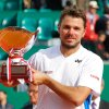 Photo - Stanislas Wawrinka of Switzerland holds his trophy after defeating Roger Federer of Switzerland in their final match at the Monte Carlo Tennis Masters tournament,  in Monaco, Sunday, April, 20, 2014. Wawrinka won 4-6, 7-6, 6-2. (AP Photo/Claude Paris)