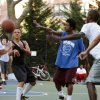 This film publicity image released by Doin\' It In The Park, LLC shows female basketball player Niki Avery, second left, playing basketball in the Spanish Harlem section of New York during filming of the documentary
