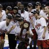 Photo - Louisville's team poses for a photo after defeating Tennessee during the Oklahoma City regional final game in the women's NCAA college basketball tournament in Oklahoma City, Tuesday, April 2, 2013.   Louisville own 86-78.  (AP Photo/Alonzo Adams)