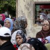 Egyptian women line up outside a polling station during a referendum on a disputed constitution drafted by Islamist supporters of President Mohammed Morsi in Cairo, Egypt, Saturday, Dec. 15, 2012. (AP Photo/Petr David Josek) ORG XMIT: PJO112