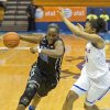 Photo - Duke's Chelsea Gray, left, drives to the basket guarded by Kansas' Cece Harper during the first half of an NCAA college basketball game in St. Thomas, U.S. Virgin Islands, Saturday, Nov. 30, 2013. (AP Photo/Thomas Layer)
