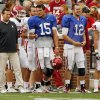 Head coach Bob Stoops and quarterbacks Drew Allen (15) and Landry Jones (12) stand on the sidelines during the University of Oklahoma (OU) football team\'s annual Red and White Game at Gaylord Family/Oklahoma Memorial Stadium on Saturday, April 14, 2012, in Norman, Okla. Photo by Steve Sisney, The Oklahoman