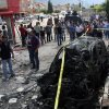 Photo - The site of one of explosions after several explosions killed at least 40 people and injured dozens in Reyhanli, near Turkey's border with Syria, Saturday, May 11, 2013, Turkish Interior Minister Muammer Guler said.(AP Photo/IHA) TURKEY OUT