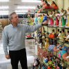 Photo - Ruben Garcia, manager and owner of Garcia's souvenir shop, checks prices on clay dolls in his store in Matamoros, Mexico, Friday, Feb. 28, 2014. In the midst of a three-year increase in American tourism in Mexico, communities along the Rio Grande are trying to win back U.S. tourists and revitalize their tourism industry. (AP Photo/Olga Rodriguez)