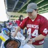 Ryan Reddell, Worcester, Mass. (formerly from Bartlesville, Okla.) cooks in the A parking lot before the college football game between the University of Oklahoma Sooners (OU) and the University of Cincinnati Bearcats (UC) at Paul Brown Stadium on Saturday, Sept. 25, 2010, in Cincinnati, Ohio. Photo by Steve Sisney, The Oklahoman