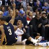 Russell Westbrook (0) reacts to a foul next after diving for a ball with Indiana\'s George Hill (3) during the NBA game between the Oklahoma City Thunder and the Indiana Pacers at the Chesapeake Energy Arena, Sunday, Dec. 8, 2013. Photo by Sarah Phipps, The Oklahoman