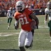 Oklahoma State\'s Justin Blackmon (81) runs past Baylor\'s defense on a reverse that went for a touchdown during the college football game between the Oklahoma State University Cowboys (OSU) and the Baylor University Bears at Boone Pickens Stadium in Stillwater, Okla., Saturday, Nov. 6, 2010. Photo by Chris Landsberger, The Oklahoman