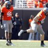 Oklahoma State\'s Ryan Robinson (96)and Cooper Bassett (80) celebrate a sack during a college football game between the Oklahoma State University Cowboys (OSU) and the Baylor University Bears (BU) at Boone Pickens Stadium in Stillwater, Okla., Saturday, Oct. 29, 2011. Photo by Sarah Phipps, The Oklahoman