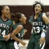 EDLAM / CELEBRATION: Edmond Santa Fe\'s Courtney Walker, right, celebrates with Cameerah Graves and Daisha Gonzaque, left, after their win over Edmond Memorial in a girls high school basketball game at Edmond Memorial on Tuesday, January 25, 2010. Photo by Bryan Terry, The Oklahoman