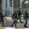 Photo - Thai soldiers walk outside the National Broadcasting Services of Thailand (NBT) building Tuesday, May 20, 2014 in Bangkok, Thailand. Thailand's army declared martial law in a surprise announcement in Bangkok before dawn on Tuesday, intensifying the turbulent nation's deepening political crisis. The military, however, denied a coup d'etat was underway.  (AP Photo/Apichart Weerawong)