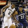 San Antonio Spurs\' Kawhi Leonard (2) and Memphis Grizzlies\' Rudy Gay (22) battle for a loose ball during the first quarter of an NBA basketball game, Wednesday, Jan. 16, 2013, in San Antonio. (AP Photo/Eric Gay)