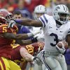 Photo -   Kansas State wide receiver Chris Harper, right, tries to break a tackle by Iowa State defensive back Jeremy Reeves (5) and linebacker Jake Knott (20) during the first half of an NCAA college football game, Saturday, Oct. 13, 2012, in Ames, Iowa. (AP Photo/Charlie Neibergall)
