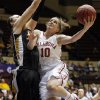 OU\'s Morgan Hook (10) shoots against Missouri\'s Christine Flores (50) during the Big 12 tournament women\'s college basketball game between the University of Oklahoma Sooners and the University of Missouri Tigers at Municipal Auditorium in Kansas City, Mo., Thursday, March 8, 2012. Photo by Nate Billings, The Oklahoman