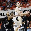 Oklahoma State guard Phil Forte, right, is fouled by Portland State center Lamont Prosser, left, in the second half of an NCAA college basketball game in Stillwater, Okla., Sunday, Nov. 25, 2012. Oklahoma State won 81-58. (AP Photo/Sue Ogrocki)