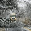 WINTER / COLD / WEATHER: Fallen tree limbs make it difficult for drivers to navigate along Britton Road, west of Midwest Blvd. Ice storm in eastern Oklahoma County, Monday morning, Dec. 10, 2007. By Jim Beckel, The Oklahoman. ORG XMIT: KOD