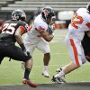 Photo -   Oregon State's Malcolm Agnew rushes with the ball during their spring NCAA college football game, Saturday, April 28, 2012, in Corvallis, Ore. (AP Photo/The Corvallis Gazette-Times, Andy Cripe) MAGS OUT