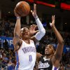Oklahoma City\'s Russell Westbrook (0) goes past Sacramento\'s Jason Thompson (34) during an NBA basketball game between the Oklahoma City Thunder and the Sacramento Kings at Chesapeake Energy Arena in Oklahoma City, Friday, Dec. 14, 2012. Photo by Bryan Terry, The Oklahoman
