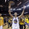 Golden State Warriors\' Stephen Curry celebrates after a 92-88 win over the Denver Nuggets during Game 6 in a first-round NBA basketball playoff series in Oakland, Calif., Thursday, May 2, 2013. (AP Photo/Marcio Jose Sanchez)