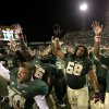 Photo - Baylor's Cody Wetsel, front left, Jason Osei, Cyril Richardson (68) and Jay Lee (4) celebrate on the field following an NCAA college football game against Iowa State, Saturday, Oct. 19, 2013, in Waco, Texas. Baylor won 71-7. (AP Photo/Tony Gutierrez)